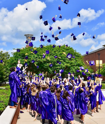 graduates throwing caps