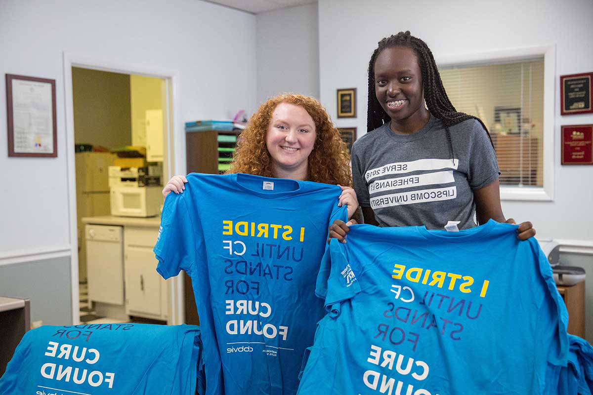 Students show off t-shirts for a cause