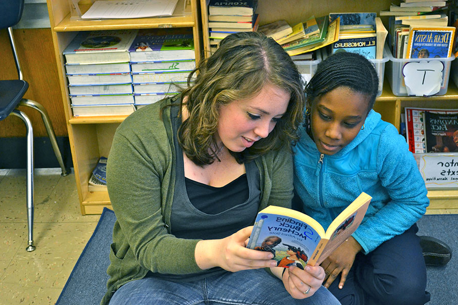 Mission work includes reading to young friends
