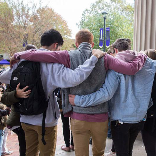 Students pray together in the center of campus.